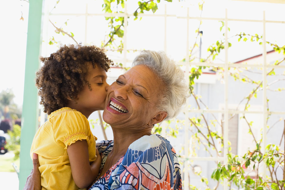 Assisted living lifestyle at Charter Senior Living of Poplar Creek - Grandmother with her granddaughter